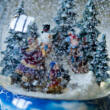 Childrens with campfire - musical snowglobe