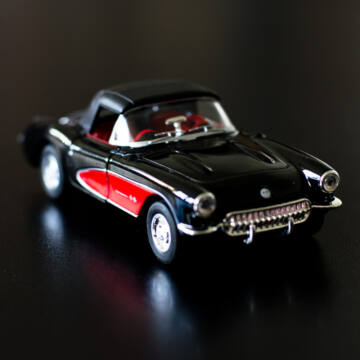 Fekete Chevrolet Corvette 1957 modell autó  1:34