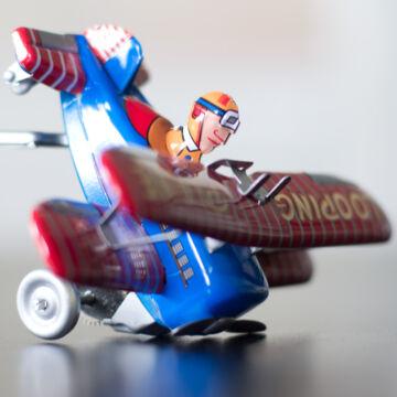 Tumbling plane tin toy